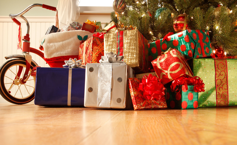 1508492811-christmas-presents-under-tree.jpg