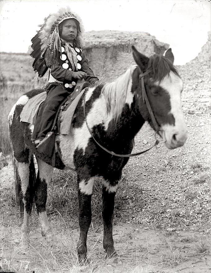Native boy on a pony.png
